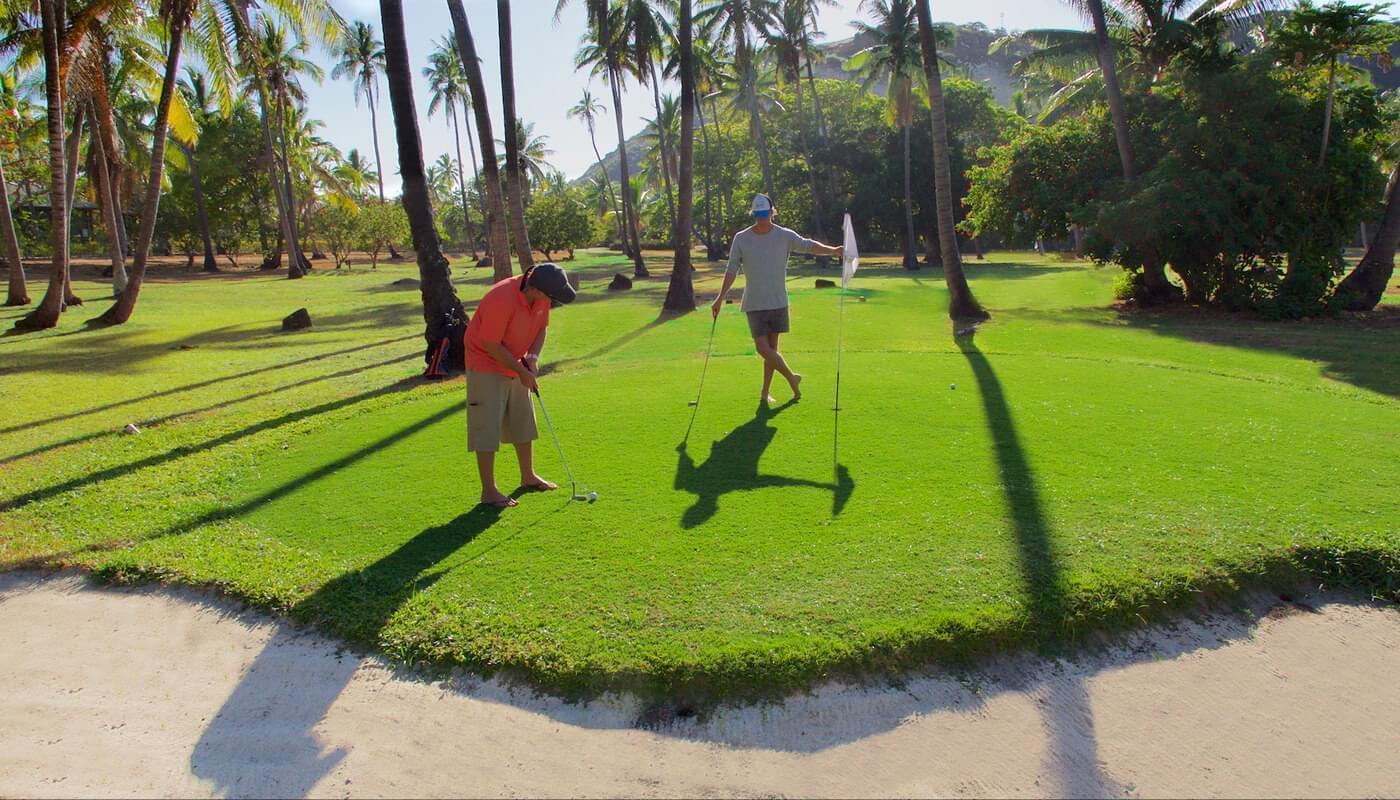 Playing golf at Vomo Island Resort