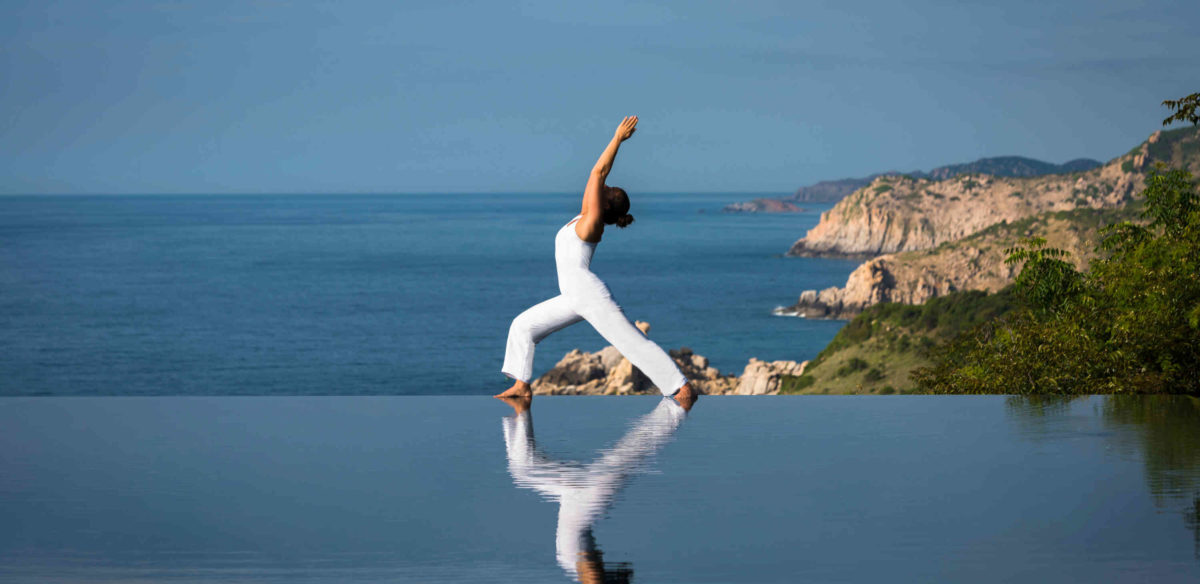 Yoga at Cliff pool at Amanoi resort wellness retreat