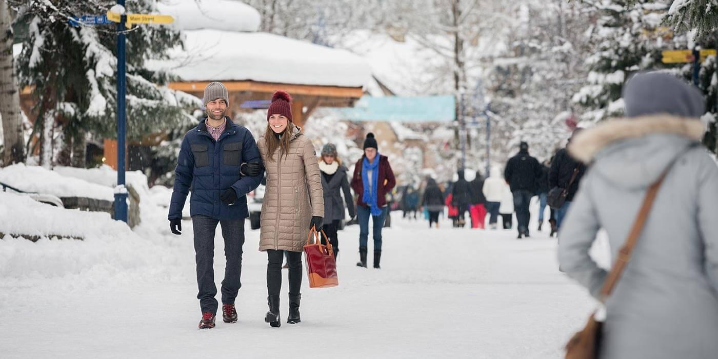 Couple walking through Whistler, Canada
