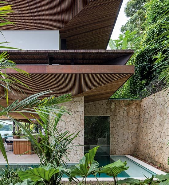 Timber and stone soften the contemporary design at Residência AB