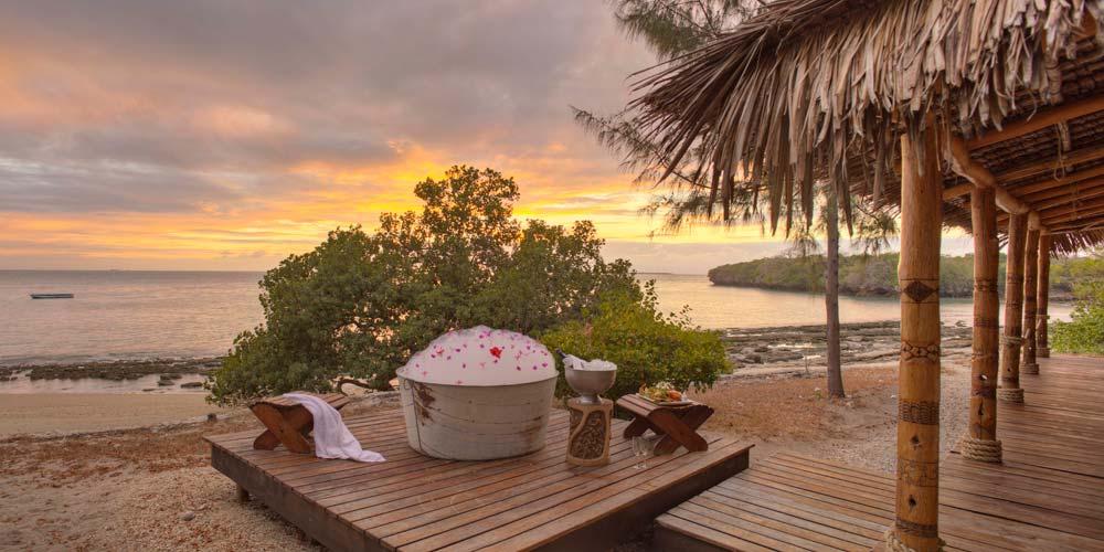 A romantic bubble bath as the sun sets at Azura Quilalea