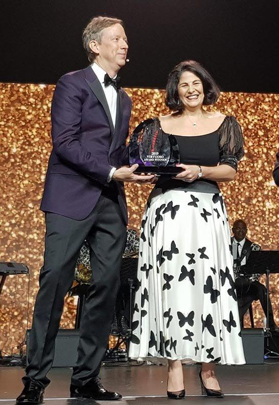 Jo Kennedy from Travel Associates receiving Virtuoso award