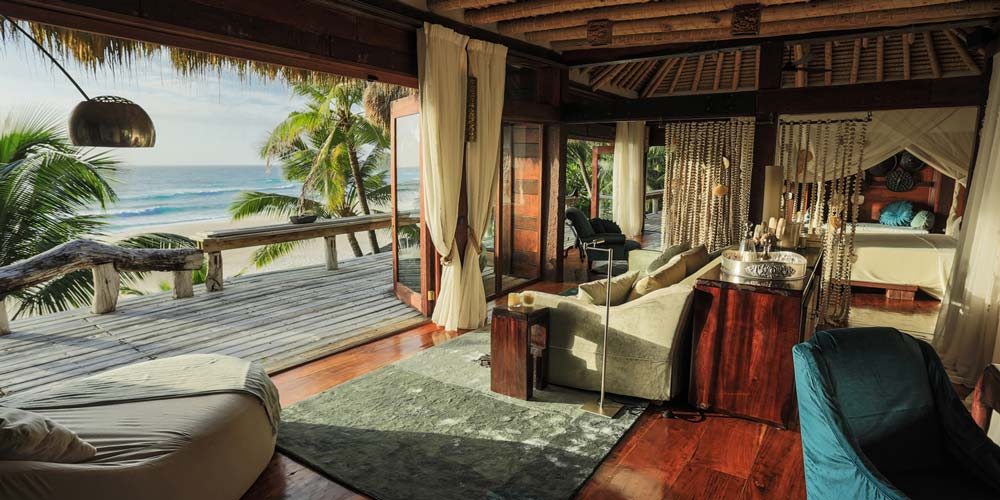 oceanfront Presidential Villas blend seamlessly into the jungle