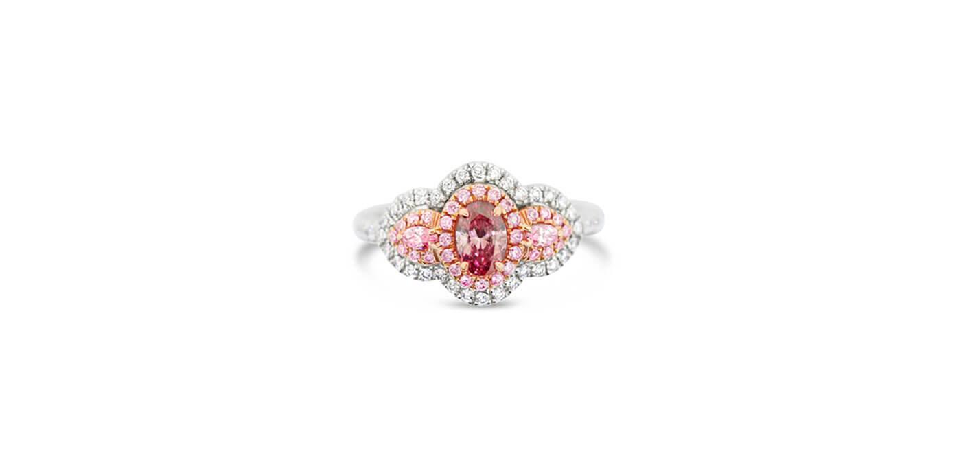 Argyle Pink Diamond and White Diamond Three Stone Set Ring in Platinum (totalling 0.47 carats)