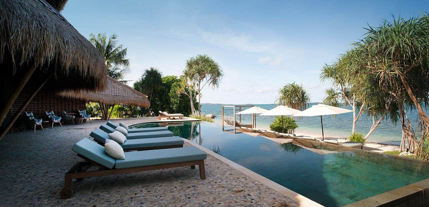 Relax by the pool at Cempedak Private Island