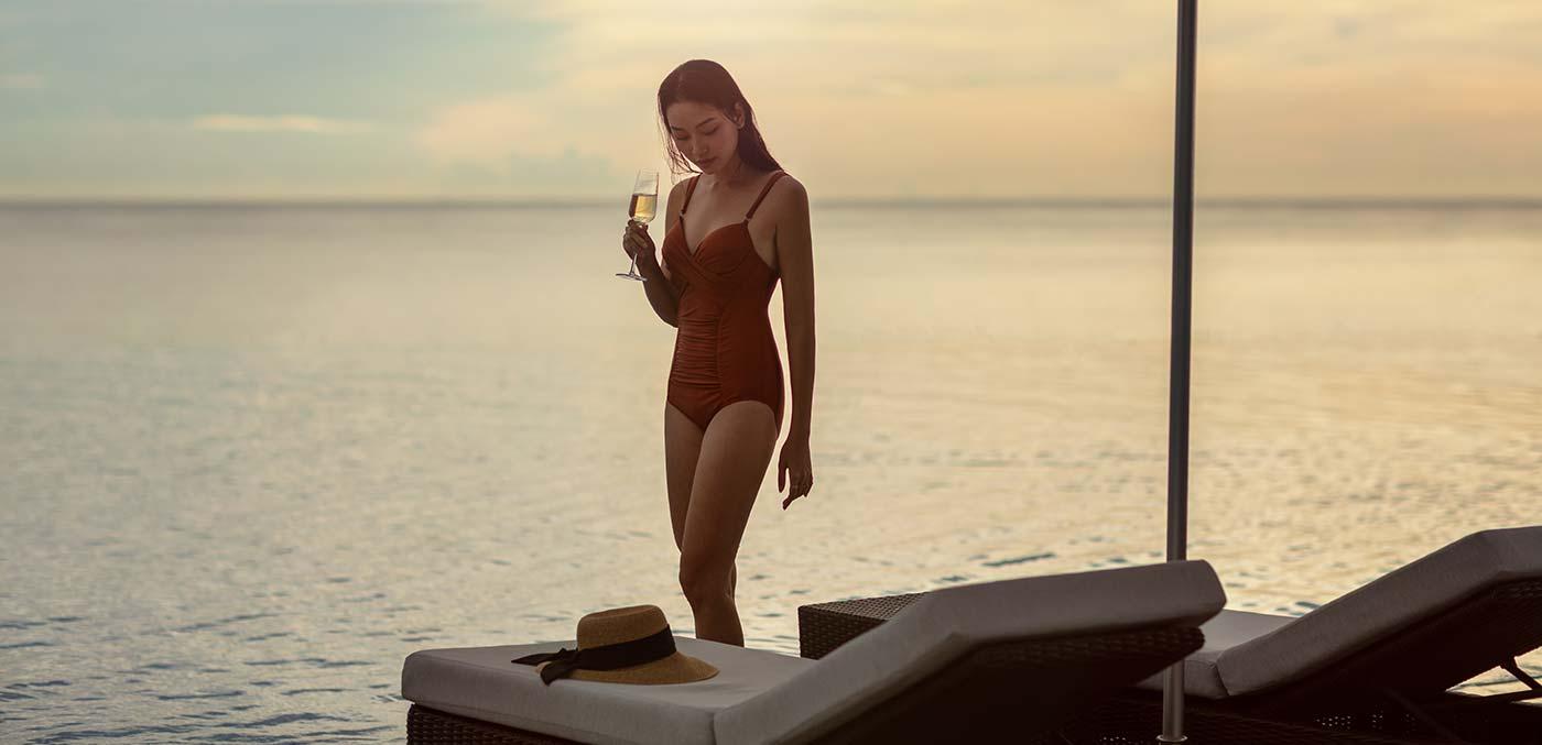 Relaxing by the pool at Sheraton Grand Danang Resort
