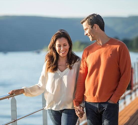 A couple walking on the Avalon Sky Deck