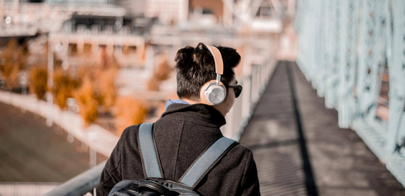 Man listening to music, travel podcasts