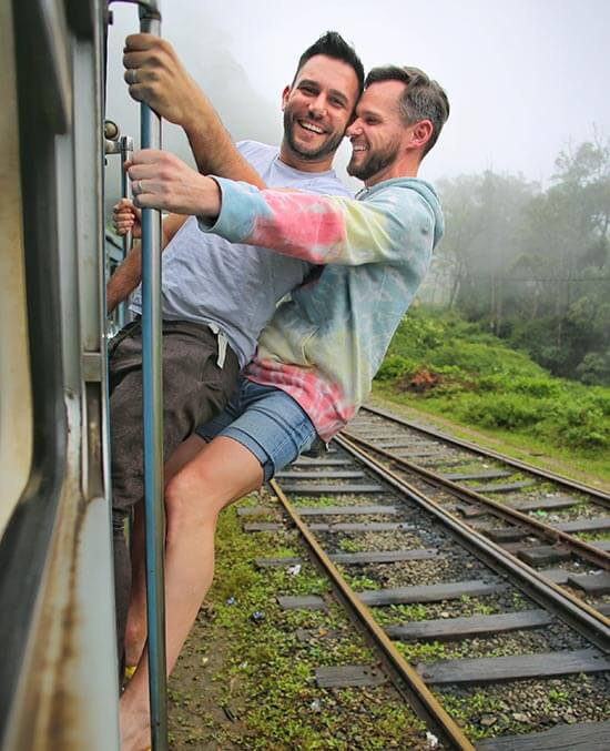 Doug and Sanj travelling by train in Sri Lanka