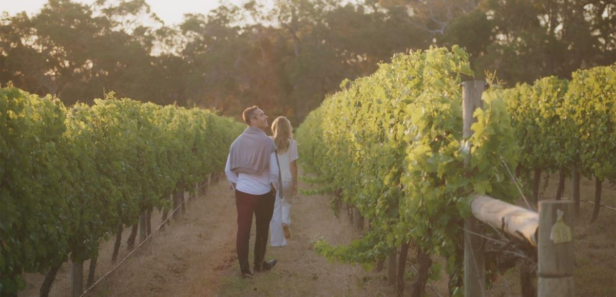 Couple walking through Cape Lodge Vineyard