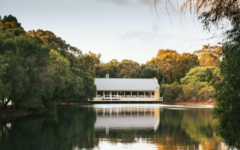 View of Cape Lodge Restaurant from the lake © Nick Cooper
