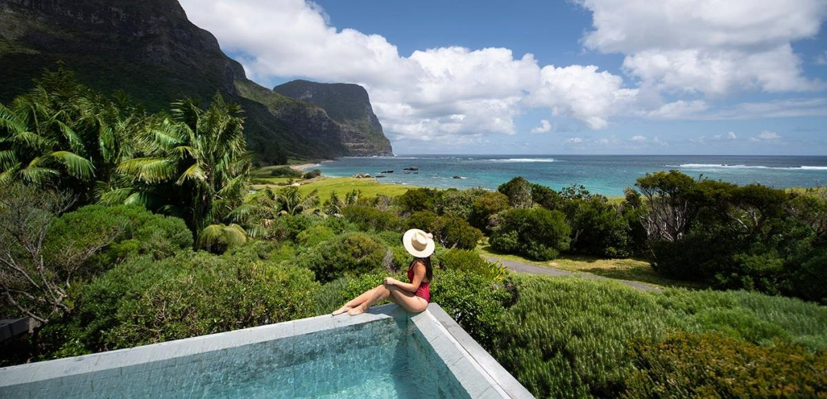 Woman by the pool at Capella Lodge, Lord Howe Island