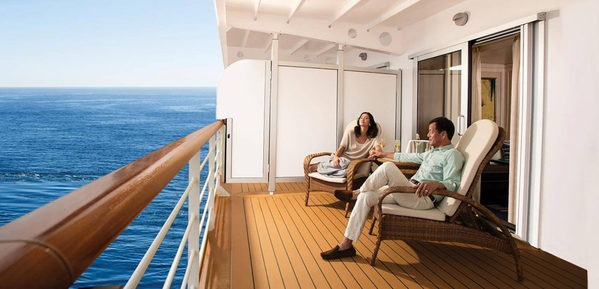 Couple relaxing onboard Seven Seas Explorer