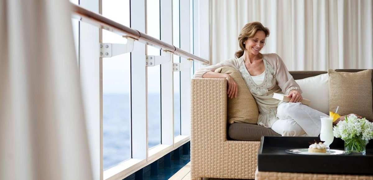 Lady lounging by the pool onboard Seven Seas Mariner