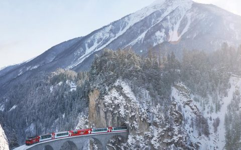 The Glacier Express carving through the dramatic Swiss countryside