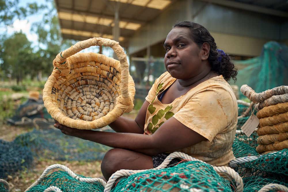 Maicie Lalara with her Ghost Net Baskets © Anindilyakwa Arts