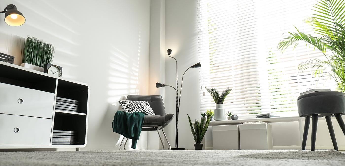 Carpeted living room with underfloor heating