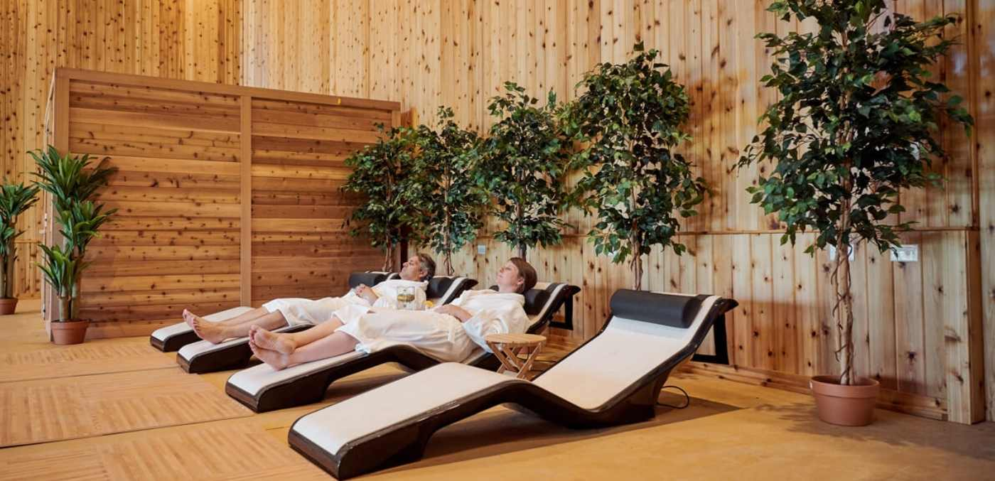 A couple laying in robes at the Eupepsia Wellness Resort